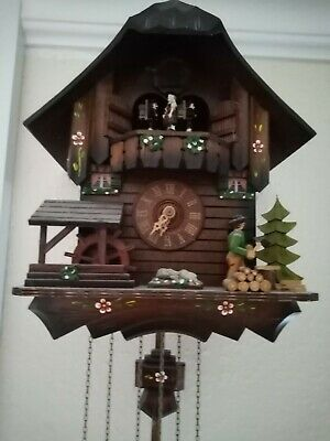 musical dancing wood chopping Cuckoo clock