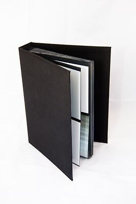 "Brand new Professional Quality Photo Albums 5x7"" holds 160 photos"