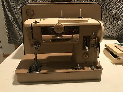 Vintage Singer Sewing machine 401A, And Attachments