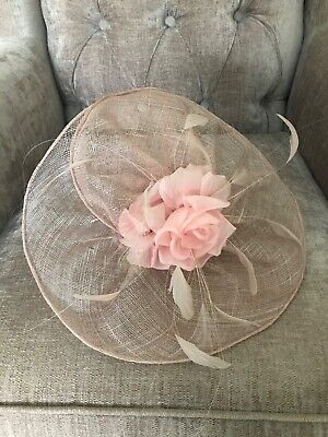 Phase Eight dusky pink fascinator featuring a rose and feathers