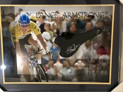 Lance Armstrong framed and signed bike saddle and large poster great souvenir