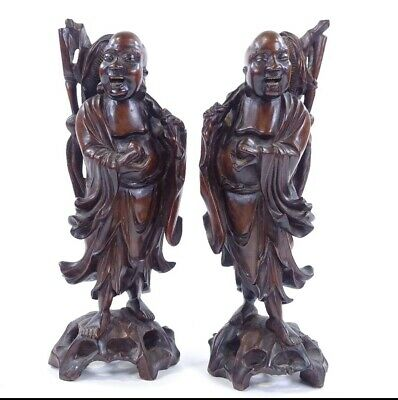 A 19th Century pair of Chinese  carved hardwood figures,
