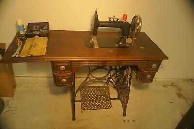 1895 Antique New Home Treadle Sewing Machine with Manual and Accessories