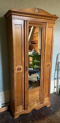 Antique freestanding wardrobe with mirror