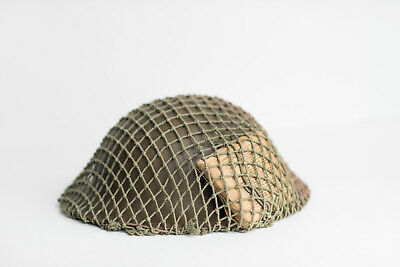 Canadian Brodie Helmet with Netting and Field Dressing