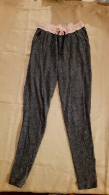 Dark grey joggers with pink waistband