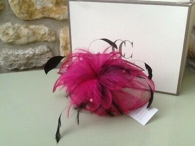 Fascinator, cerise pink with black feathers on ribbon covered wire band