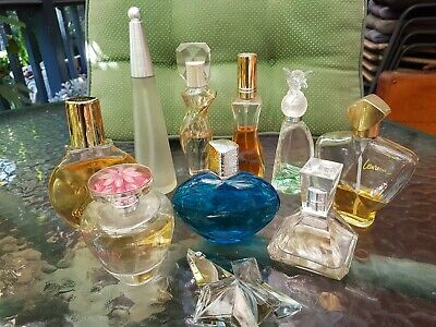 10 very collectable perfume bottles, some still got perfume