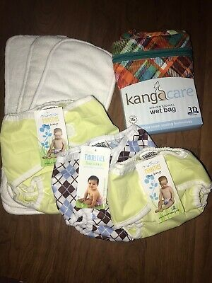 NEW Cloth Diaper Lot 7 Piece Lot. Rumparooz Wet Bag Thirsties Duo Wrap