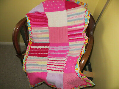 Lovely hand knitted baby blanket with pretty brushed cotton contrast backing - a