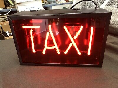 neon sign taxi