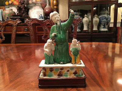 A Rare Chinese Qing Dynasty Kangxi Ceramic Statue with Wooden Stand.