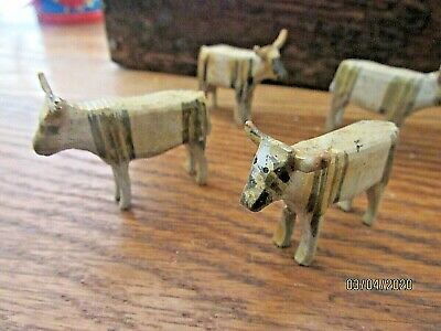 Antique miniature folkart hand carved cows German ? old wooden toy miniatures