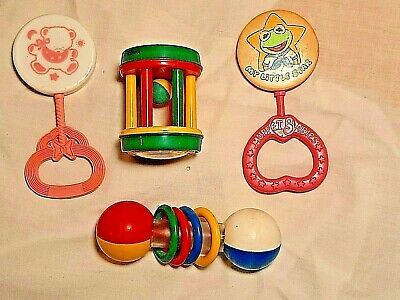 Four Vintage Plastic Baby Toys Rattles Dumbell & Rolling Rattle
