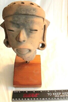 Pre-Columbian Pottery Head on wood stand, Dramatic, 8 inches by 7 inches