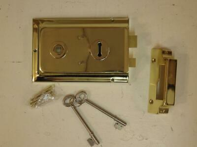 Brass plated over pressed metal rim lock and keeper, 2 keys,federation/deco