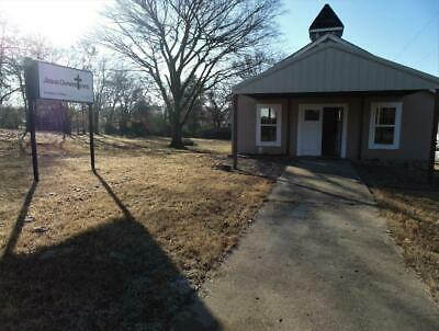 Church 1600 sq ft on .48 acre with playground Close to Ft Smith, Ar Many uses!
