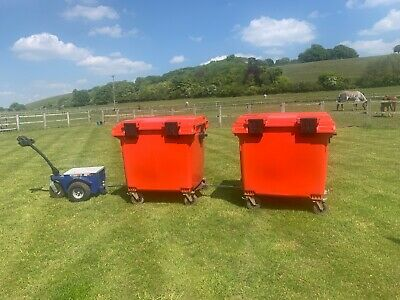 Zally electric towing machine with two 1100litre recycling bins.