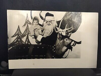Rppc Santa Claus Holds Baby With Reindeer
