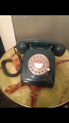 Retro style rotary phone, fits standard sockets, adapter included.