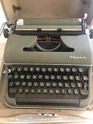 Vintage Olympia Typewriter & Case Werke AG. Made in West Germany. Good condition