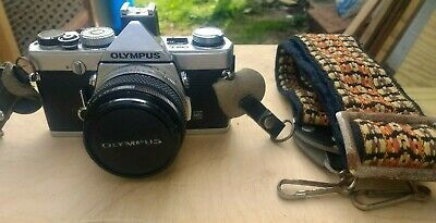 OLYMPUS OM-1N 35mm SLR CAMERA with Zuiko 50mm 1.8 LENS And Period correct strap.