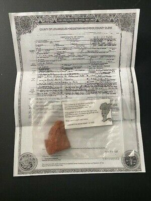 Piece of brick from Lucille Ball's home wall and copy of death certificate