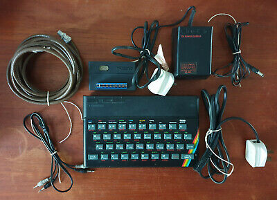 Sinclair ZX Spectrum 48K, manual, various cables and games (some boxed)