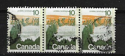 Canada # 594  Landscape  error Type I Used strip of 3 major under ink and tag