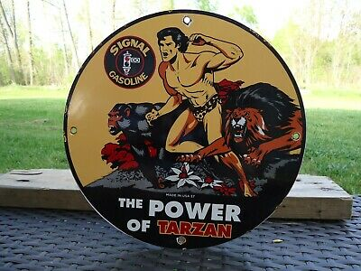 Vintage Old 1957 Tarzan Signal Gasoline Porcelain Service Station Pump Sign