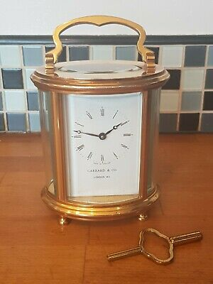Garrard & Co London W1 Oval Brass Carriage Clock With Key Bevelled Glass Ex...