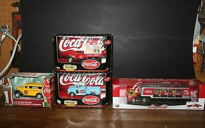 """4 Different Coca Cola Brand """"Die Cast Trucks"""" New in Their Display Boxes"""