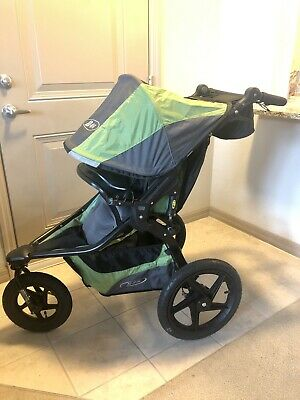 BOB Revolution Pro Black and Green Stroller With Accessories and Travel Bag