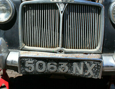 dateless car number plate 5063 nx. on rover car. 1960.
