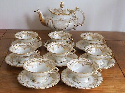 Unmarked Tea Set with Tea Pot and 8 Tea Cup and Saucers