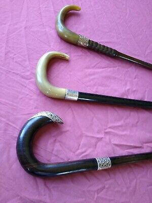 antique walking canes x2 horn handles. 1wood good condition.silver