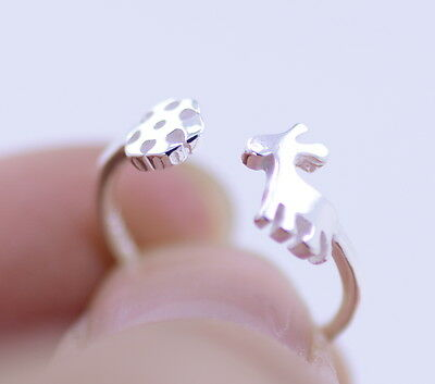 Silver tone snowflake and reindeer open ring, UK Size K