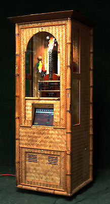 automated Ukulele in cabinet jukebox