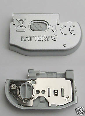 New Nikon COOLPIX L4 Battery Chamber Lid/Door SILVER