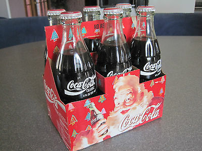 6 pack coca cola happy holidays santa full bottles 1994 cardboard carrier inc.