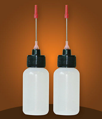 Two 1 OZ bottles with needle tip dispenser