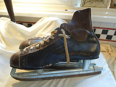 VINTAGE  LEATHER BLACK AND BROWN ALL STAR CANADIAN MENS SIZE 12 SKATES  #325