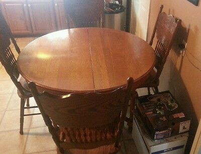 Quarter Sawn Oak Table, Round, 48 inches in diameter, 3 Leaf (extensions)