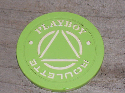 ROULETTE CHIP (GRN TRI) FROM THE PLAYBOY CASINO, ATLANTIC CITY