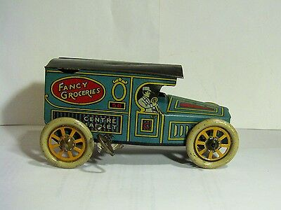 RARE ANTIQUE CHEIN TIN WIND UP FANCY GROCERIES CENTRE MARKET DELIVERY TRUCK