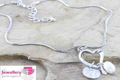 Single metal Heart pendant and a cultured pearl on a snake chain necklace silver