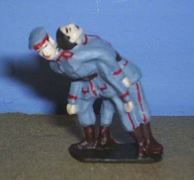 TOY SOLDIERS TIN WORLD WAR 1 WWI GERMAN SOLDIER CARRYING COMRADE FROM FRONT