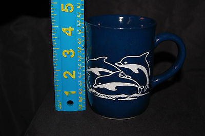 Beautiful blue embossed Dolphins riding waves ceramic tea/coffee cup