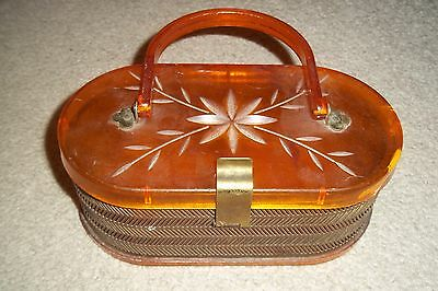 Vintage Marie Windsor Tortoiseshell Lucite Purse With Open Metal Work .