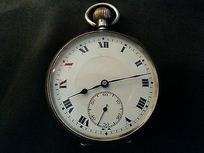 Antique pocket clock made of silver.